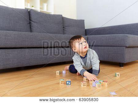 Baby boy creeping at home