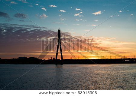 Sunset bridge river Daugava Riga