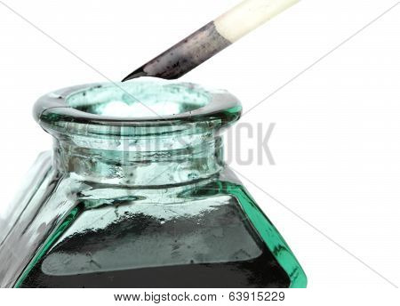 Quill pen and glass ink bottle