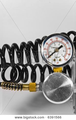 Compressor Pressure Gauge With Black Pipes On White Background.
