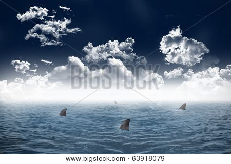 Digitally generated shark infested sea under dark sky