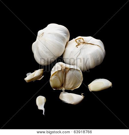Garlic Bulbs On Black Background