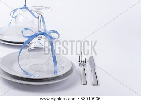 Festive Table Set With Glasses And Silverware On White Background