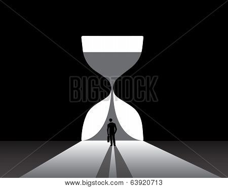 Businessman Silhouette Standing Front Of Big Hour Glass Door
