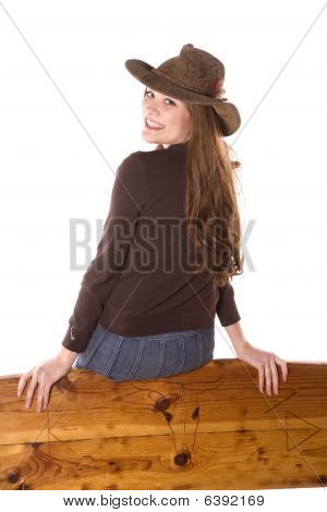 Happy Woman On Back Of Bench