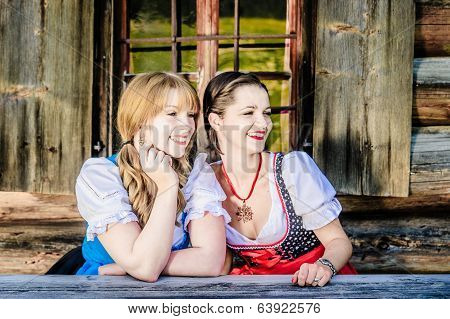 Sitting Woman in traditional austrian clothes
