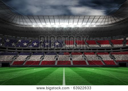 Digitally generated american national flag against large football stadium