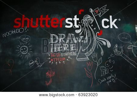 NEW YORK-APR 24: Shutterstock chalk wall at the Filmmaker Industry Party at Spin during the 2014 Tribeca Film Festival on April 24, 2013 in New York City.