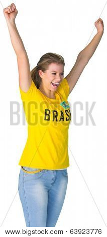 Excited football fan in brasil tshirt on white background