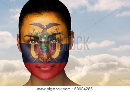 Composite image of beautiful brunette in ecuador facepaint against beautiful blue sky with clouds