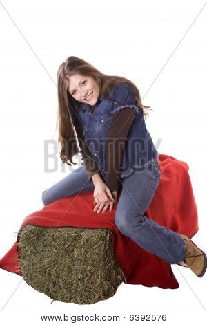 Woman On Hay Bale With Red Blanket