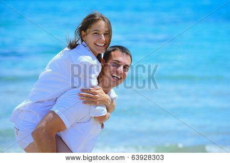 happy young couple have fun and relax  on the beach