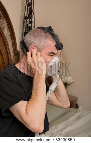Man wearing his CPAP machine before sleeping