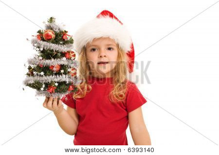 Little Girl Holding Small Decorated Tree At Christmas Time