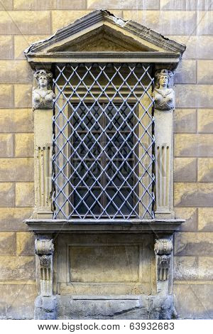 Fortified Sandstone Window With Carvings