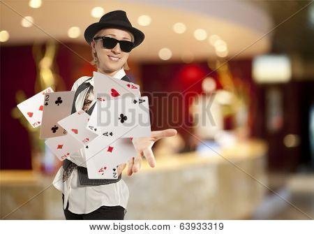 Bluff, happy blonde woman in cap playing with poker cards