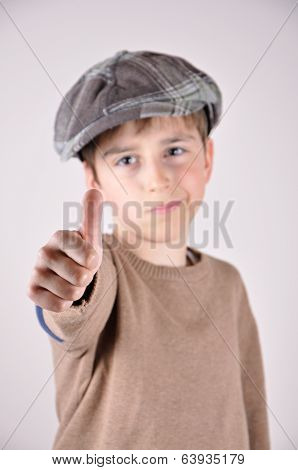 Young boy with a thumb up