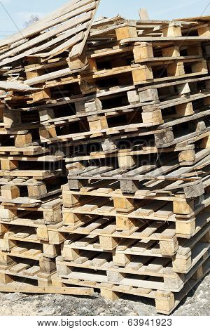 Stack Of Empty Pallets In Warehouse