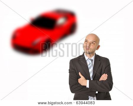 Business Man With Bald Head Thinking And Dreaming Of Luxury Sports Ca