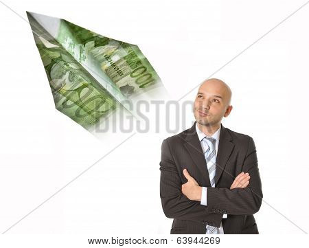 Young Business Man With Bald Head Thinking And Dreaming Of Big Money