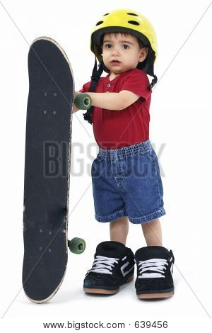 Small Boy With Large Helmet Shoes And Skateboard