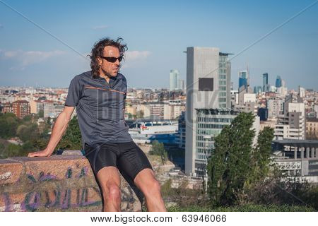 Long Haired Athlete Taking A Rest After Running