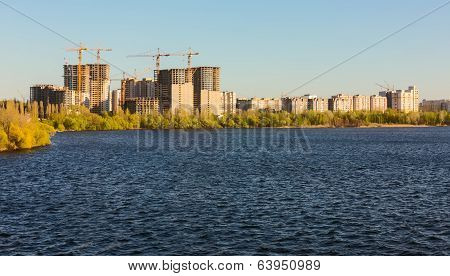Building Of City Habitation On Bank Big River