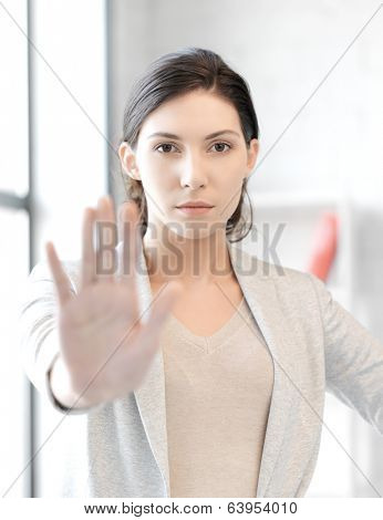 business concept - young woman making stop gesture