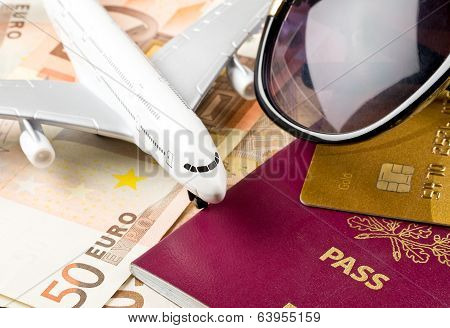 Money, Documents And Sunglasses