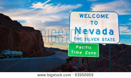 Welcome to Nevada state border sign with clouds and a blue sky in the background
