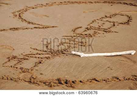 Engaged Written In Sand