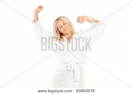 Woman in bathrobe stretching isolated on white background