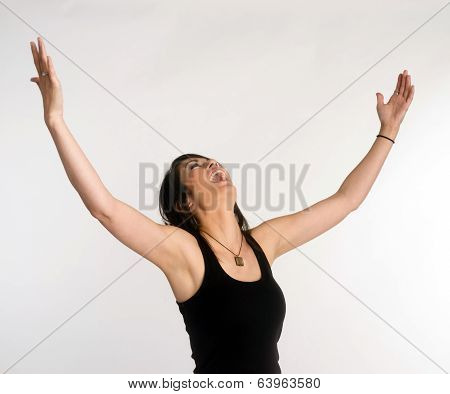 Pretty Brunette Woman Holds Arms Outstretched Jubilant Looking Up
