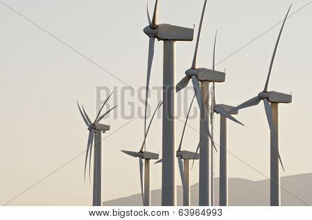 Windmills for renowable electric production with white sky, Zaragoza province, Aragon, Spain
