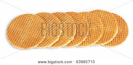 Round ruddy waffles isolated on white background