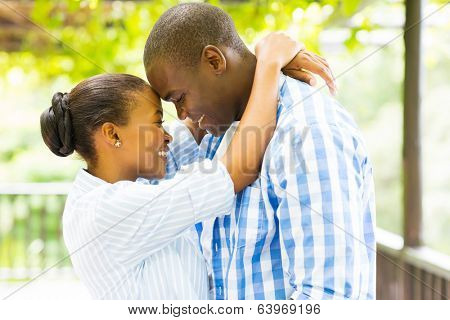 happy young african couple embracing outdoors