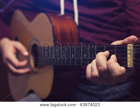 Man Playing Music At Wooden Classic Guitar