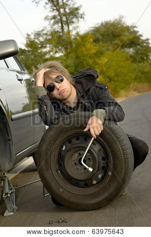 Man with wheel on the road