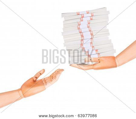 big packs of dollars in wooden hand isolated