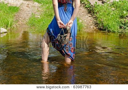 Girl Legs With Dress Standing In Flowing Stream