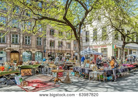 STRASBOURG, FRANCE - APRIL 16: FLEA MARKET IN THE TOWN CENTER. Strasbourg's historic center with a flea market on the square APRIL 16, 2014 2014 in Strasbourg, France.