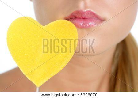 Heart Shape Candy On Woman Macro Mouth