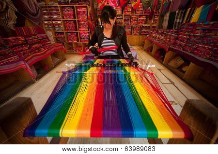Chinese Naxi Woman Weaving Shown To Tourists In Lijiang Dayan Old Town.
