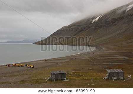 Svalbard, Norway - July 2013: Tourists Observing Walruses in Edgeoya