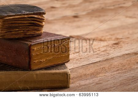 Old Book Stack, Brown Pages Blank Spine, Macro Of Aged Library Heap On Table