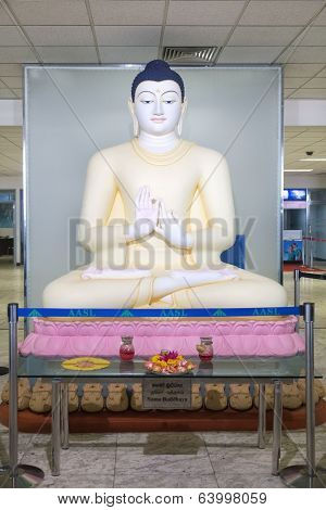 COLOMBO, SRI LANKA - FEBRUARY 19, 2014: Big Buddha statue located in the Transit area at Bandaranaike International Airport. Statue was unveiled by president Mahinda Rajapaksa, on 8th August 2011.