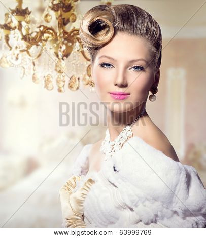 Luxury Styled Beauty Lady Portrait. Retro Woman. Beauty Fashion Vintage Style Girl with Beautiful Hairstyle, makeup, accessories. Golden Silk Gloves, dress, expensive white fur coat, Luxury interior