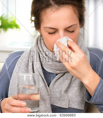 Sneezing woman into tissue. Sick Woman. Flu. Woman Caught Cold. Allergy. Headache. Virus. Medicines