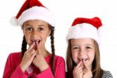 pic of child missing  - two girls wearing santa hats missing teeth - JPG
