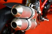 picture of exhaust pipes  - Close up shot of a motorcycle exhaust pipes - JPG